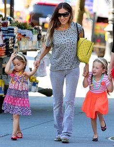 Sarah Jessica Parker's twins Loretta (left) and Tabitha rocked their own individual styles as they traipsed around NYC's West Village with their famous mom