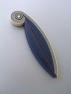 A stylish corrugated cardboard brooch created by Anne Finlay.