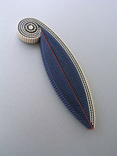 Corrugated cardboard brooch by Anne Finlay.