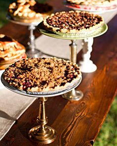 For a unique and DIY cake stand, affix flea market china plates to candlesticks, then use them to serve homemade pies