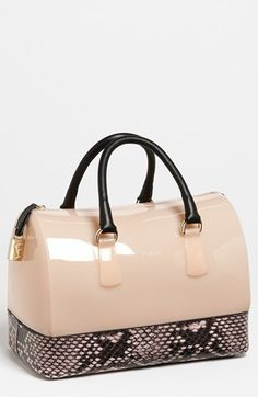 This is a fabulous bag - updated Boston-bag with a rubber and snake embossed leather - so fun!!!