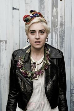 Phenomenal: Scarf in hair, leather jacket, flowers. (sorry, source unknown)