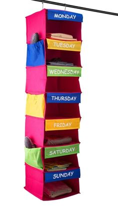A days of the week closet organizer that'll help you plan your (and your kids')…