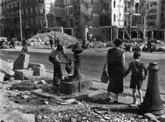 Barcelona. Not all the water pipes are cut off despite the Italo-German air force bombings. 1938.