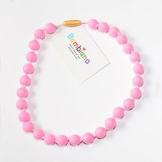 Bambiano Nicole Jr Necklace in Baby Pink. Bambiano Jr Necklaces are made of 100% Food grade silicone. BPA free, Lead free and nontoxic. Fashionable for trendy girls 3 years and above. Necklaces are colourful, washable and soft against the skin. Shop at www.bambiano.com