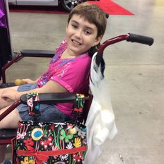 This pretty little lady loves her Demi-Premier Whimsical Garden bag! (2015 Chicago Abilities Expo)