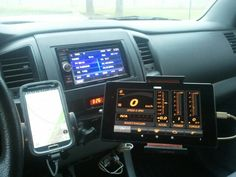 """Current augmentative connectivity setup.  7"""" tablet running Dash Command ODB2 software,  cell for GPS/mobile hot-spot, with Kenwood head unit.  Bird Dawg Industries 2nd gen Tech-deck and RAM mount hardware keep things secure and vibration free."""