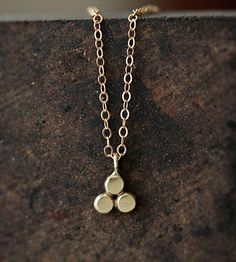 Gold Trinity Necklace | This dainty pendant necklace is crafted from 100% recycled ste... |