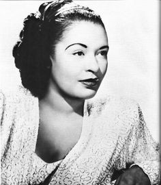 Billie Holiday.  She had a voice that few modern singers can only aspire to get close to.  You've got to live a certain life to be able to get such depth of feeling into the delivery.