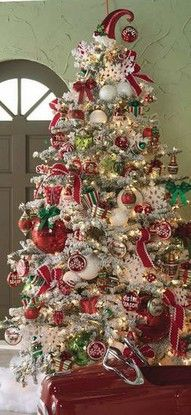 Flocked Christmas Tree with Red, Green, and Silver Ornament Theme. | #christmas #xmas #holiday #decorating #decor #xmastree