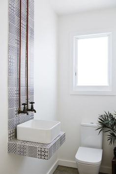 This striking tiled setup with exposed pipes that I would like in my imaginary pool house, please.