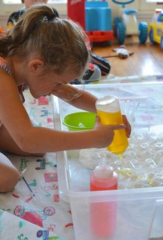 Another spin on baking soda and vinegar - mountain range of erupting volcanos.  Cut the tips of the bottoms out of a plastic egg container (styrofoam would work too). Replace lid and flip over then fill each section with baking soda.  Add liquid watercolor to squeeze bottles and let the kiddos go for it.