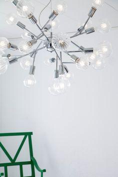 Modern chromed hanging lamp with several light bulbs in a Scandinavian living room. Scandinavian Ceiling Lighting, Pendant Lamp, Floor Lamp, Chrome, Chandelier, Table Lamp, Bronze, Scandinavian Living, Ceiling Lights