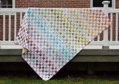 Postage stamp quilt with Central Park fabric-  And I have a jelly roll of Central Park I need to cut into!
