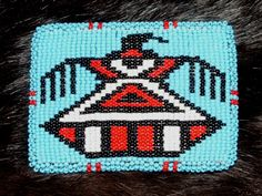 Belt Buckle Native American Beadwork THUNDERBIRD A colorful thunderbird on a beaded belt buckle. Heavy duty. Beadwork is stretched over a metal buckle with leather backing. Quality Native American Beadwork.  $75.00 w/ free shipping within USA.  #beadwork #nativeamerican #thunderbird