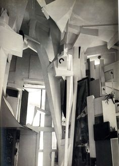 Kurt Schwitters - Merzbau (1933) Dada. The Hannover Merzbau by Kurt Schwitters. Photo by Wilhelm Redemann, 1933. Schwitters worked on the Hanover Merzbau from around 1923 until 1937, when he fled to Norway to escape the threat of Nazi Germany. Sadly, in 1943, while he was in exile, it was destroyed in an Allied bombing raid. The original Merzbau was gone forever.
