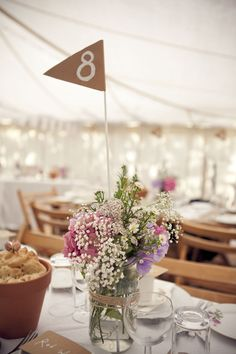 Table numbers and cute casual and easy table arrangements