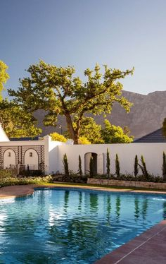 Leeu House, an exclusive retreat in the scenic Franschhoek Valley, Cape Winelands, South Africa. Garden Features, East Africa, Where To Go, Swimming Pools, Cape, Scenery, Backgrounds, Wanderlust, Ocean