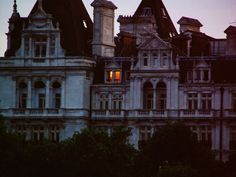 Untitled, purple mansion across lake at dusk, in suitably alchemical witch purple light.
