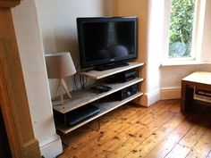 Shelves created from reclaimed Chapel floorboards and 10mm iron bar