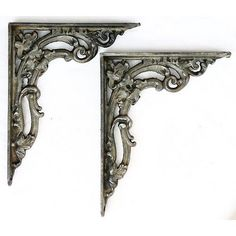 a large heavy pair of edwardian cast iron shelf brackets in super overall condition with