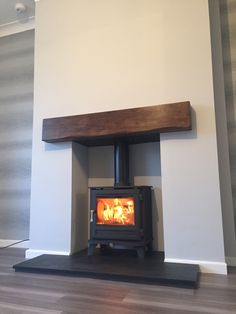 Chesney Salisbury 5 stove with a Beazilian Slate hearth and a Bespoke solid oak beam