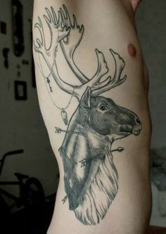 Reindeer lifework on left upper and outer arm. More from a front view like a deer mount and not the extra jargain