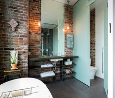 Thinking of playing up your exposed brick wall? Here are 7 Colors that Always Look Amazing With Exposed Brick! Exposed Brick Apartment, Exposed Brick Walls, Brick Bathroom, Bathroom Interior, Industrial Bathroom, Industrial Living, Industrial Style, Bathroom Ideas, Bath Ideas