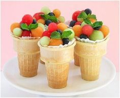 Ice cream cones filled with fruit. See more 1st boy birthday food and party ideas at one-stop-party-ideas.com