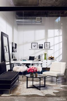 Office space with subtle marble accents paired with bright metallic and textural highlights from hide rugs