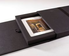 Constructed from paper over board and mdf the 4 board case with slipcase and mdf tray was concealed with an array of ribbons and magnets. Covered and lined in Winters Wibalin Buckrum and foiled in a silver these boxes truly are luxurious.