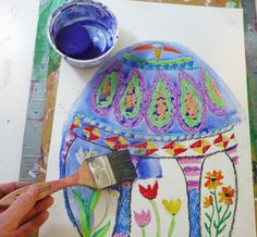 Using watery disk tempera (a wash) paint over the entire egg. The pastel areas will resist the paint.