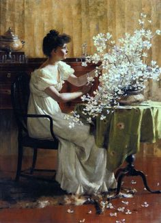 """Woman arranging flowers"" by Francis Coates Jones (1857-1932)."