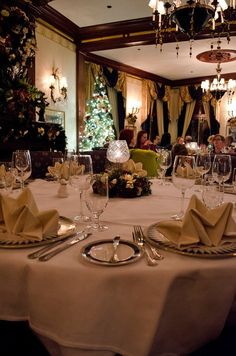 The main dining room at Club 33 decked out in Christmas regalia and perfectly arrayed place settings.
