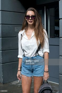 Estelle Pigault in jean shorts with Chanel suspenders for London Fashion Week Spring/Summer 2016/17
