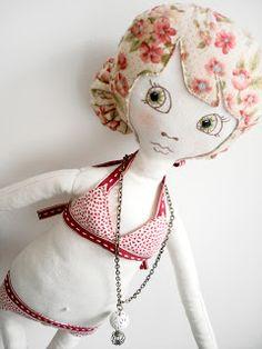 Supercutetilly. Love this doll; the fabric hair.