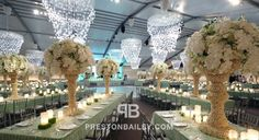 candles ceiling treatment centerpiece chandelier crystals flowers reception table setting tall centerpiece tent wedding color|green color|wh...