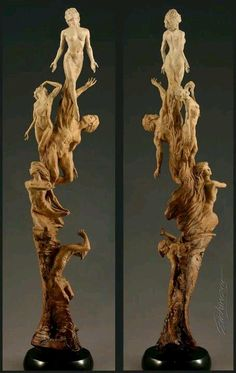 Wood carving. I love how these figures are stacked.