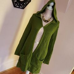 Duster sweater Green Duster sweater with hood. Large pockets in front. Hook and eye closure in front. Snuggly soft. Great to layer on a chilly day. Sweaters Cardigans