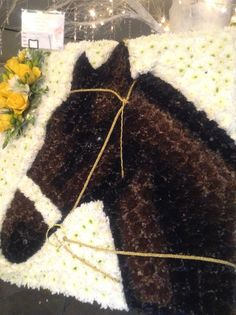 Funeral Flowers. Horse funeral flower tribute, horses head funeral flower tribute, bespoke funeral flowers, unusual funeral flowers, brown horse funeral flowers, picture of a horse in flowers. www.thefloralartstudio.co.uk