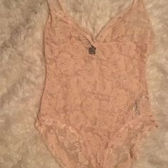 Nude rose lace bodysuit Tag was snagged a little on a hanger but other than that in great condition...only tried on  never worn. Forever 21 Intimates & Sleepwear