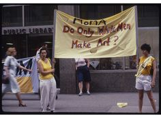 """June 14, 1984 - Women protest because MOMA's exhibition the """"International Survey of Painting and Sculpture,"""" featured 169 artists, all of which were white and less than 10 percent of those were women.   Photos by Clarissa Sligh. Subjects include Lucy Lippard, May Stevens, Linda Cunningham, Emma Amos, Sabra Moore, Sharon Jaddis, and Alida Walsh.   The posters were pasted all over Soho, a vastly different place from the Soho of today."""