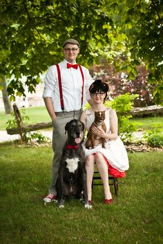Red on dress, red shoes, suspenders, bow tie, and dogs. What could be better?