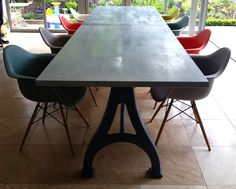 Industrial based dining tables from recycled steel and iron with oak tops