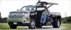 Modified Silverado 2500 w/ gull wing doors provides shelter from elements while loading. >>> See it. Believe it. Do it. Watch thousands of SCI videos at SPINALpedia.com