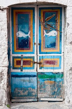 Ponza Island, Italy I've pinned A LOT of these really rustic but colorful doors. They describe my home decor style perfectly. Rustic and colorful. Its just beautiful.