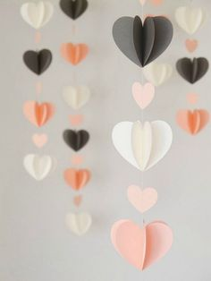 These twirly heart garlands make for a perfectly playful decor piece for your Galentine's Day brunch. Idées déco Saint Valentin DIY - Decoration ideas for Valentines Day Crush On These DIY Hearts (Handmade Charlotte) Ah, February, it's the season of l Saint Valentin Diy, Paper Heart Garland, Paper Garlands, Diy Y Manualidades, Diy Décoration, Diy 3d, Paper Hearts, 3d Hearts, Hearts Decor