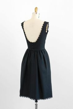 vintage 1960s little black backless lace trimmed Audrey Hepburn dress.