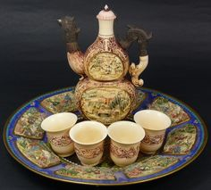 Set includes a relief carved double gourd shaped teapot with Chicken spout