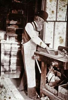 Wise man by his workbench.